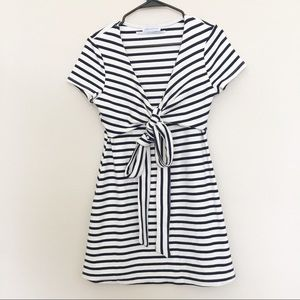 Urban Outfitters   Black & white striped dress.